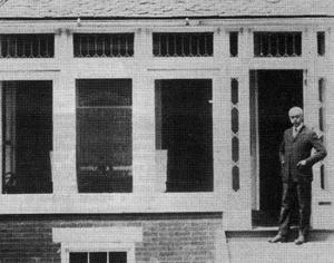 Photo of Isadore Maximilian Martin in Front of Real Estate Office